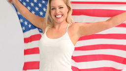 Woman holding a USA flag Stock Video Footage