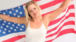 Woman holding a USA flag Footage