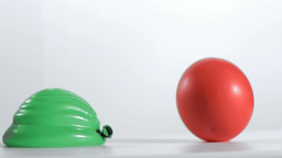 Two balloons rebounding in super slow motion Footage