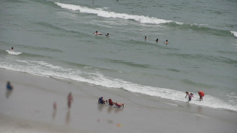 1821 People Enjoying the Beach with Ocean Waves in Footage