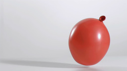Red balloon rebounding in super slow motion Footage