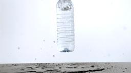 Water bottle rebounding in super slow motion Footage