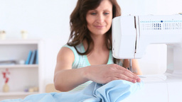 Brunette woman using a sewing machine Stock Video Footage