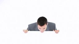 Businessman hiding beside a board Footage