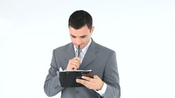 Young businessman writing on a notepad Footage