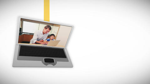 Video of family using a laptop in a kitchen Animation