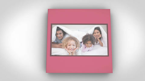 Family videos on a book against a white background Stock Video Footage
