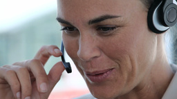 Businesswoman talking into a headset Footage