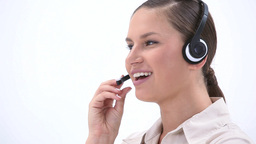 Woman talking into a headset Stock Video Footage