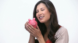 Woman kissing a piggy bank Stock Video Footage