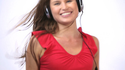 Woman wearing a headphone while dancing Stock Video Footage