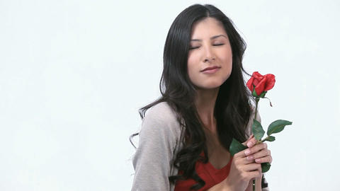 Woman smelling a rose Stock Video Footage