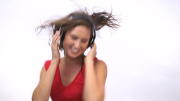 Woman dancing while wearing headphone Footage