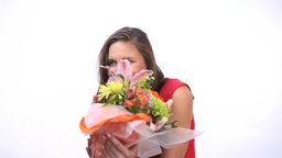 Happy woman receiving a bunch of flowers Footage