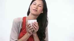 Woman smelling a mug Footage
