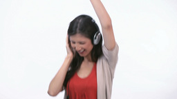 Woman jumping and dancing with headphone Footage