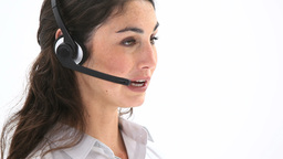 Business woman speaking into a headset Stock Video Footage