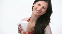 Happy woman holding a mug Footage