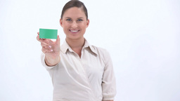 Classy woman showing a green card Stock Video Footage