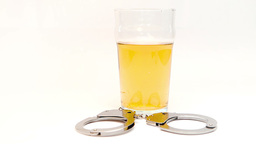 Car keys falling in a glass full of beer surrounde Stock Video Footage