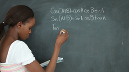 Video of a black student writing on a blackboard Stock Video Footage