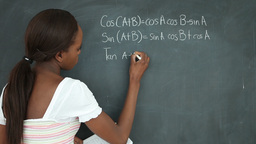 Video of a black student writing on a blackboard Footage
