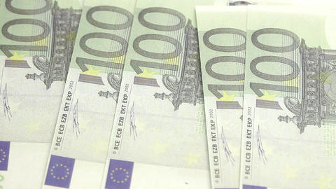 Euro bills displayed by a hand on a table Stock Video Footage