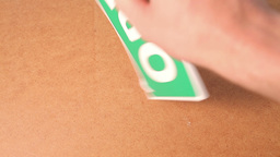 Hand Turning A Sign From Close To Open stock footage