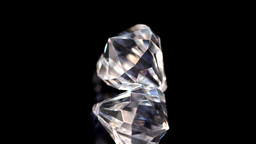 Two diamonds in super slow motion spinning Footage