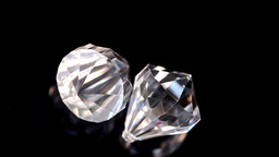 Two diamonds in super slow motion spinning Stock Video Footage