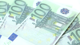 Hundred euro bills displayed by a hand on a table Stock Video Footage