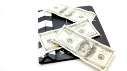 Dollar Bills Placed On A Cinema Clap stock footage
