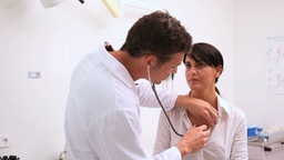 Doctor listening of the breathing of a patient Footage