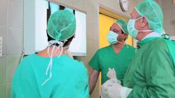 Medical team examining a Xray Stock Video Footage