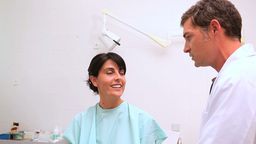 Woman patient being auscultated by a doctor Footage