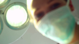 Nurse looking at a patient waking up Stock Video Footage