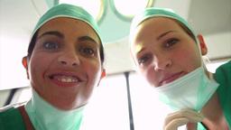 Surgeons above a patient Footage