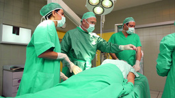 Surgical team around a patient Stock Video Footage