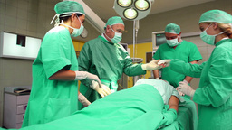 Surgical team around a patient Footage