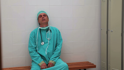 Irritated surgeon sitting on a bench Stock Video Footage