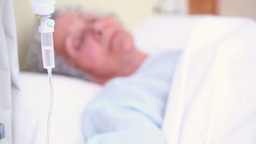 Elderly patient sleeping on a medical bed Footage