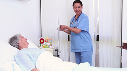 Nurse giving a meal to a patient Stock Video Footage