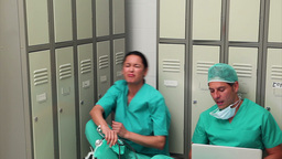 Surgeons sitting while talking Stock Video Footage