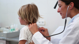 Child being auscultating by a doctor Footage