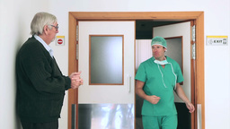 Surgeon talking in the corridor Stock Video Footage