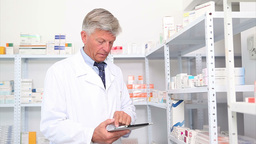 Pharmacist standing behind a hospital counter Stock Video Footage