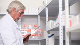 Pharmacist Behind A Hospital Counter stock footage