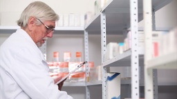 Pharmacist behind a hospital counter Stock Video Footage