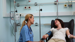 Nurse speaking with a transfused patient Stock Video Footage