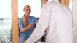 Nurse giving a folder Footage